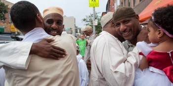 Sunni Muslims embrace each other after taking part in Eid al-Fitr prayers at a mosque in the Brooklyn borough of New York on August 8, 2013. Muslims in New York started to celebrate Eid al-Fitr on Thursday, an annual celebration which marks the end of the Islamic month of Ramadan.   REUTERS/Stephanie Keith (UNITED STATES - Tags: RELIGION) - RTX12E78